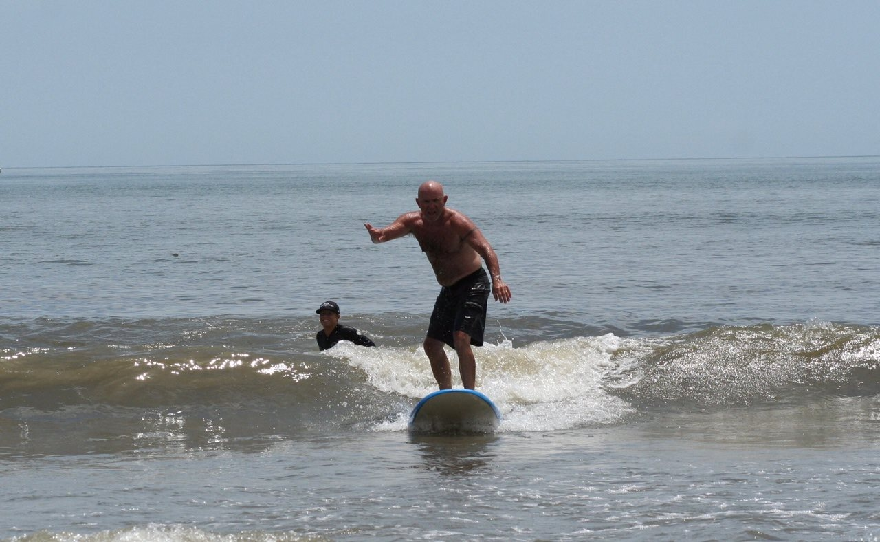 join the summer beach fun at New Smyrna Beach with surfing