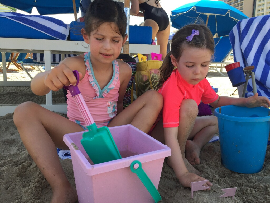join the summer beach fun in New Smyrna Beach with sand play