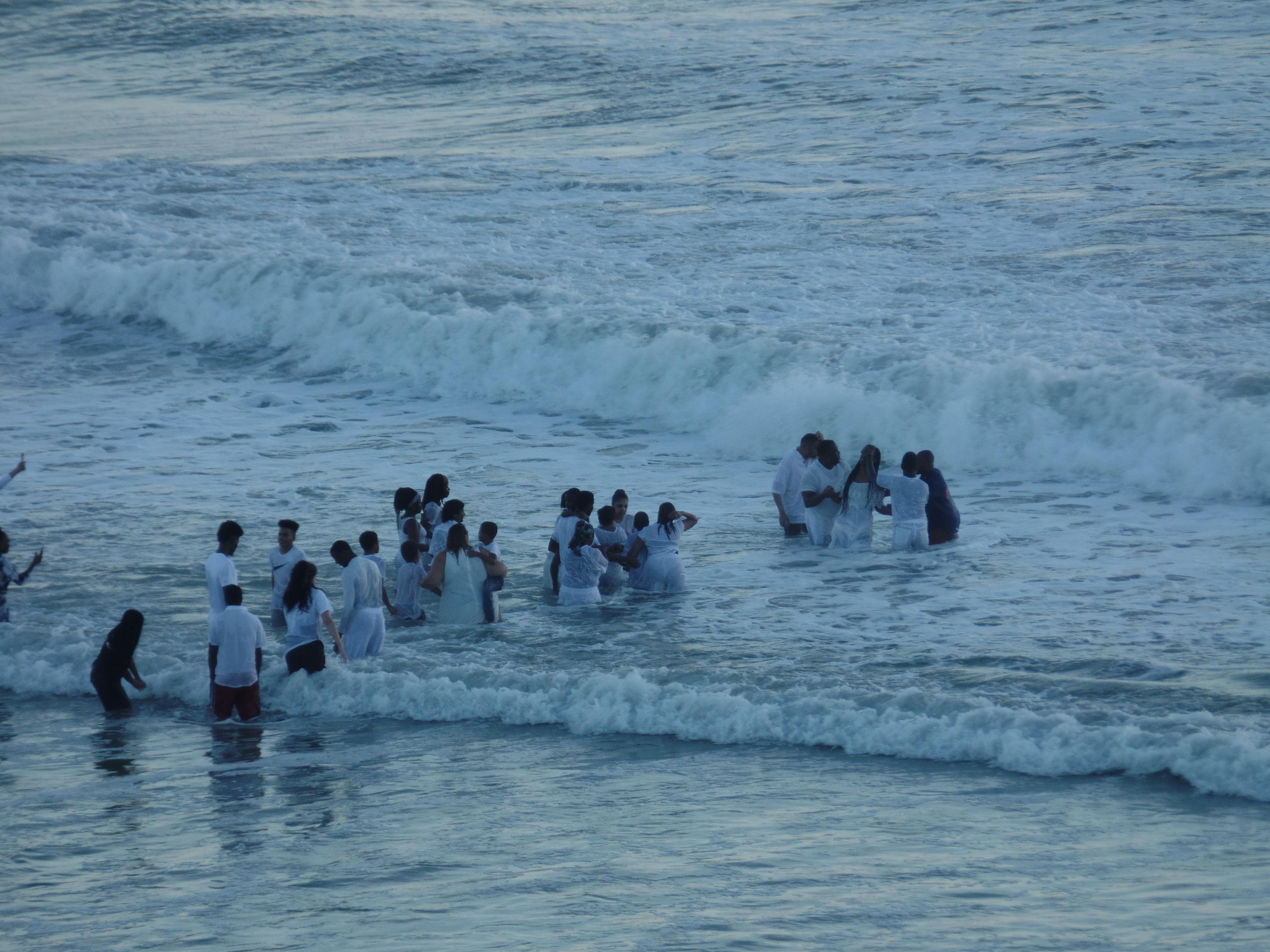 join the summer beach fun at New Smyrna Beach watching surf baptism