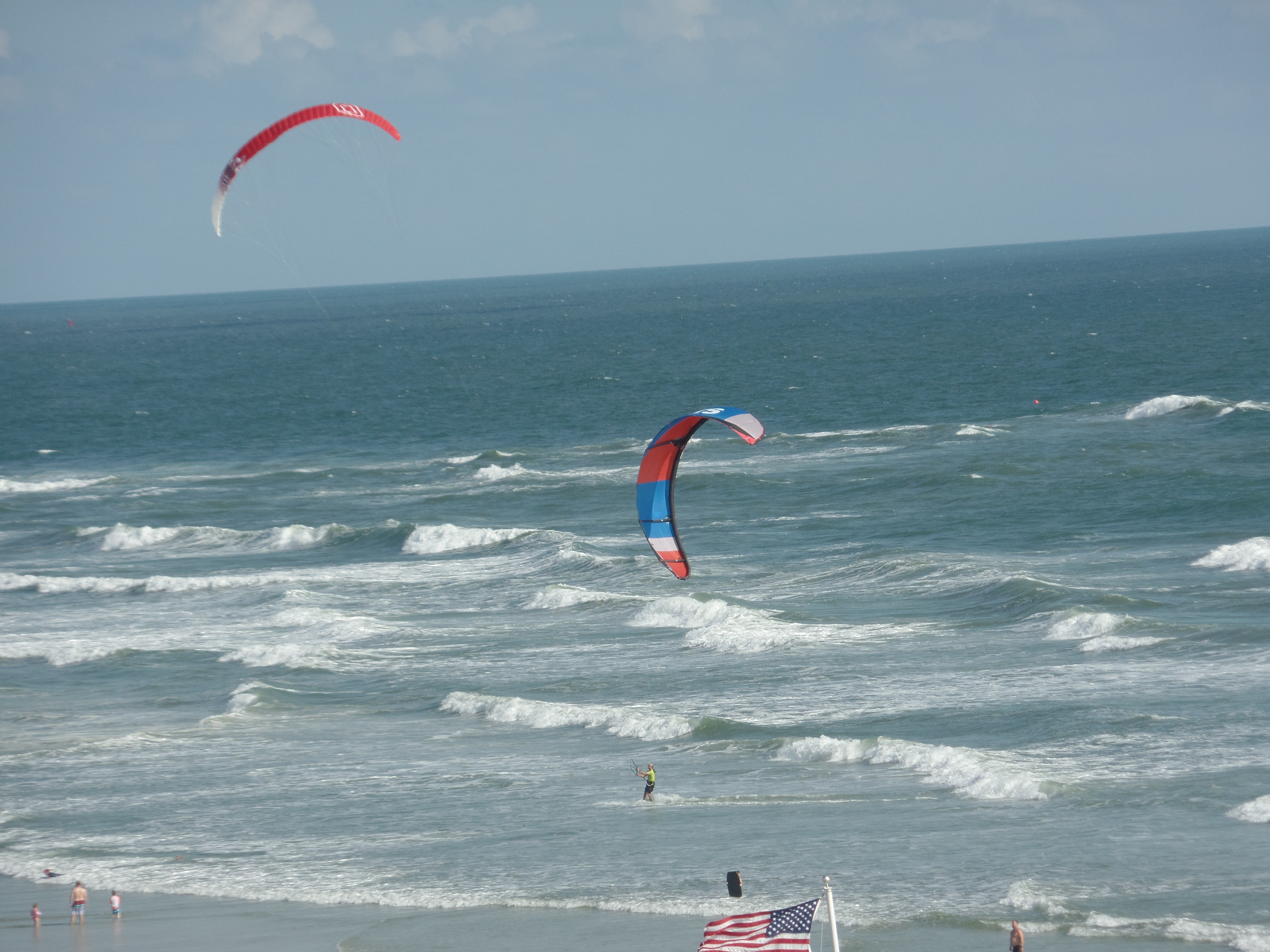 join the summer beach fun in New Smyrna Beach with kite surfing